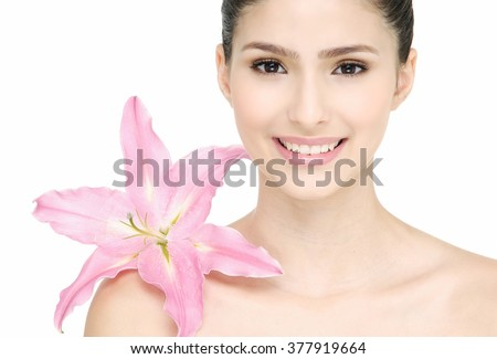 Close-up portrait of beautiful woman with natural clear make-up and lily