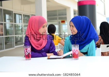 Close-up portrait of beautiful young Asian student study together at cafe