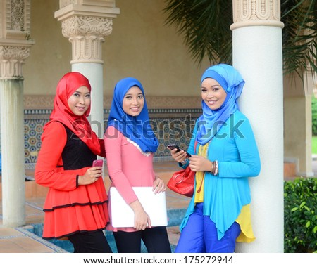 Close-up portrait of beautiful young Asian talk and meet together - stock photo