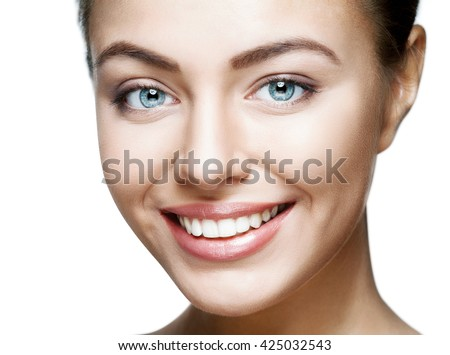 Close up portrait of beautiful young happy smiling woman.