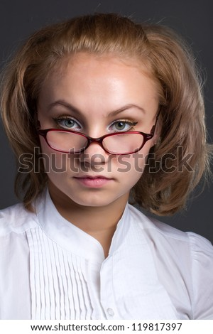 close up portrait of beautiful young woman bespectacled