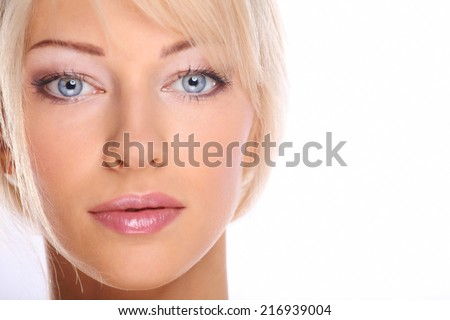 Close up portrait of beautiful young woman face. Isolated on wh - stock photo