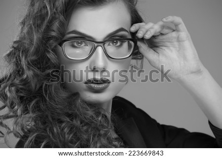 Close-up portrait of beautiful young woman in glasses