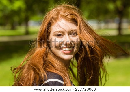 Close up portrait of beautiful young woman in the park - stock photo