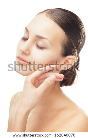 Close-up portrait of beautiful young woman with eyes closed touching her face isolated on white background - stock photo