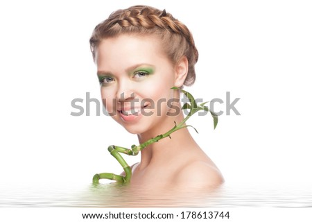 Close-up portrait of beautiful young woman with green bamboo in water. Isolaton white background - stock photo