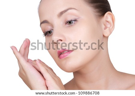 Close-up portrait of beautiful young woman with healthy clean skin of face