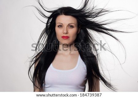 Close-up portrait of beautiful young woman with long hair. Fashion shot. Long hair concept. Studio portrait.