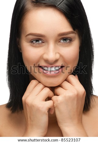 Close-up portrait of beautiful young woman with white teeth, isolated on white background