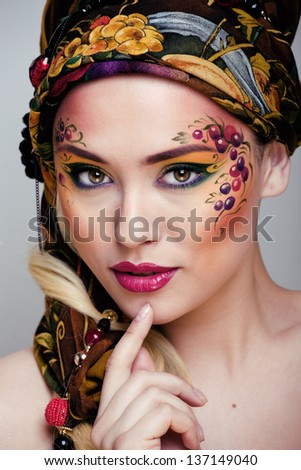 close up portrait of beauty woman with face art