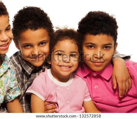 Close-up portrait of black family - boys and girls smiling - stock photo