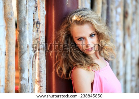 Close-Up Portrait Of Blonde Woman Looking Away - stock photo