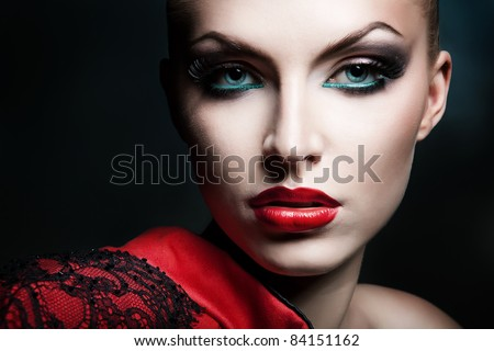 close-up portrait of blonde woman with red lips