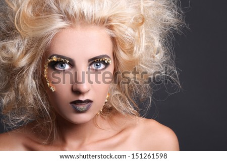 close up portrait of blondie woman with creative hairstyle