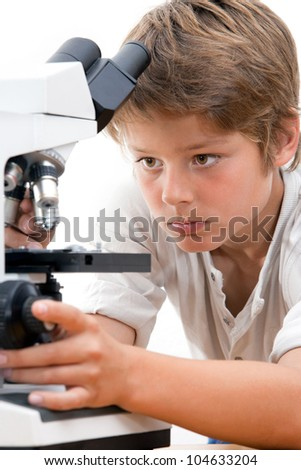 Close up portrait of boy with microscope.Isolated on white. - stock photo