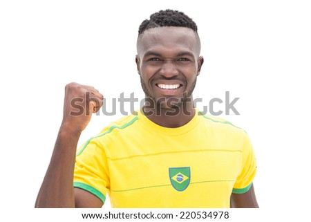 Close up portrait of Brazilian football fan cheering over white background