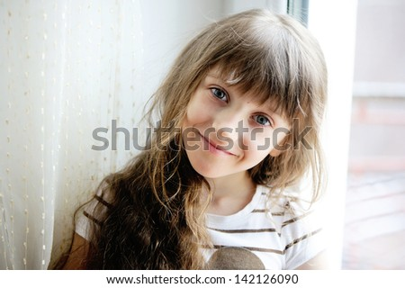 Close-up portrait of brunette child girl - stock photo