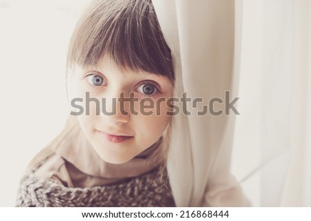 Close-up portrait of brunette child girl, sepia tone added - stock photo