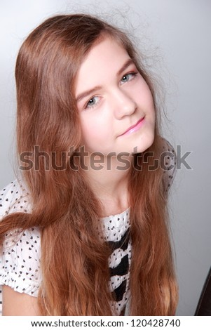 Close up portrait of brunette teenager - stock photo