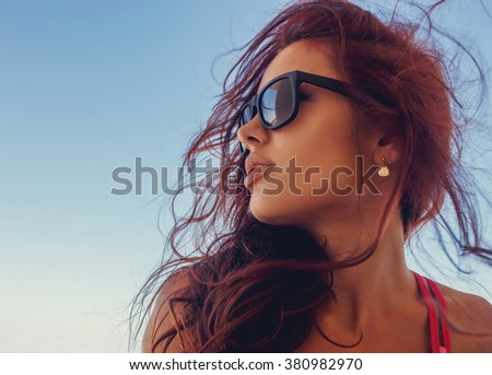 Close up portrait of brunette woman in a sunglasses. - stock photo