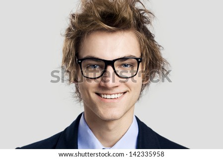 Close-up portrait of business man wearing nerd glasses - stock photo