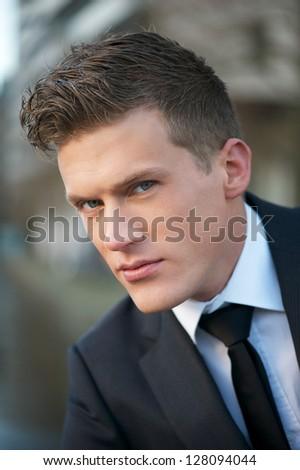 Close up portrait of businessman face - stock photo