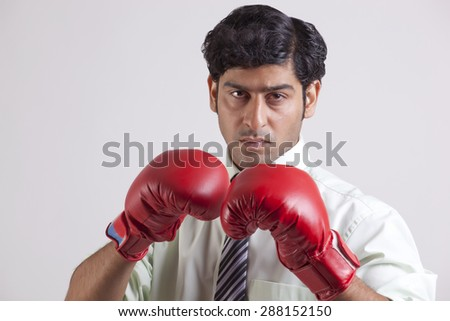 Close-up portrait of businessman wearing gloves