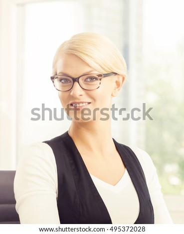 Close-up portrait of businesswoman at work. Attractive female office worker. Business concept.
