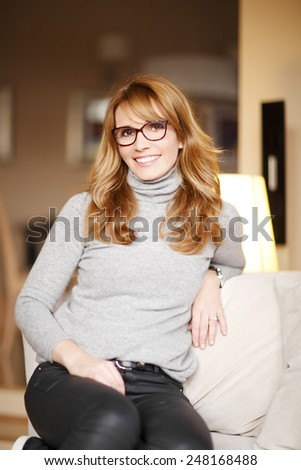 Close-up portrait of casual business woman relaxing at home. Shallow focus.  - stock photo
