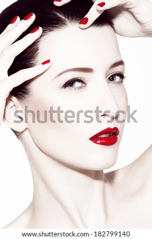 close-up portrait of caucasian brunette wearing red lipstick - stock photo