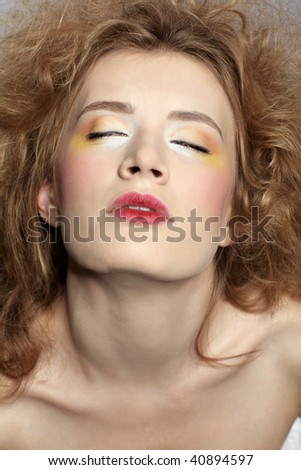 close-up portrait of caucasian girl with girl with shock hair-do
