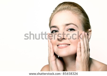 Close-up portrait of caucasian young woman - stock photo