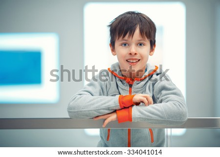 Close-up portrait of cheerful little boy indoors - stock photo