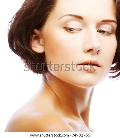 Close-up portrait of cheerful young adult girl - stock photo