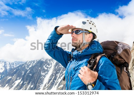 close up portrait of climber looking at the horizon in the mountains
