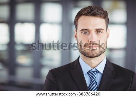 Close-up portrait of confident businessman in office - stock photo