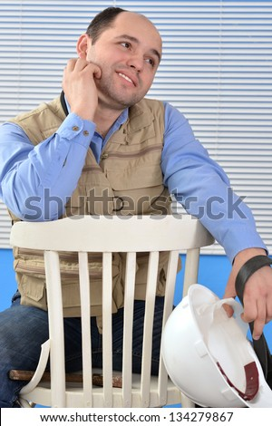 close up portrait of confident handyman in studio isolated on white