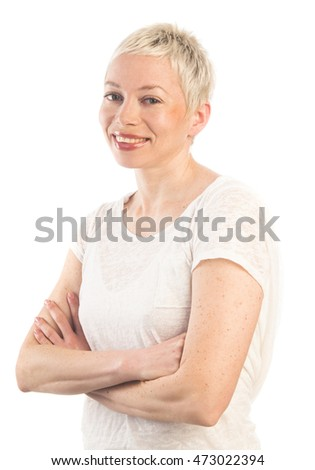 Close up portrait of confident woman with crossed hands looking at camera and smiling