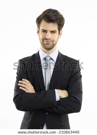 Close-up portrait of confident young businessman standing against white background.