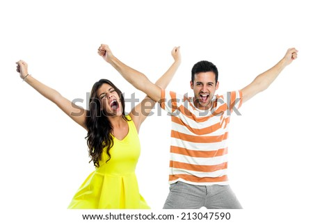 Close up portrait of couple shouting with arms raised.isolated on white background. - stock photo