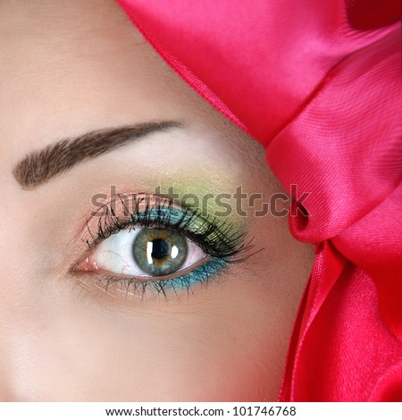 Close-up portrait of creative eye make-up - stock photo
