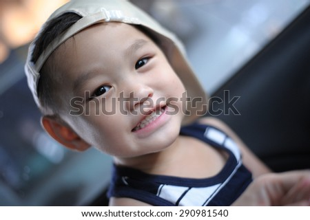close up portrait of cute asian boy smiling