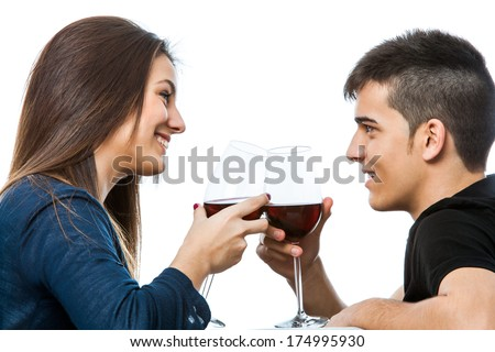 Close up portrait of cute couple drinking a glass of red wine together.Isolated on white background. - stock photo