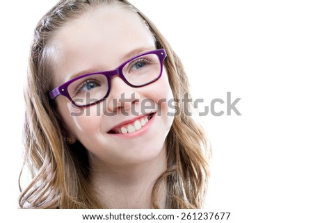 Close up portrait of Cute girl with glasses looking at upper corner.Isolated on white background.