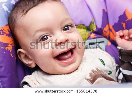 Close up portrait of cute happy little baby boy with big smile. - stock photo