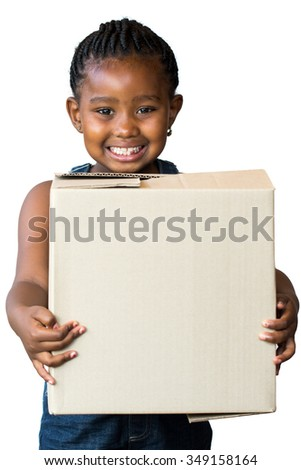 Close up portrait of cute little african girl with braided hairstyle holding big cardboard box.Isolated on white background. - stock photo