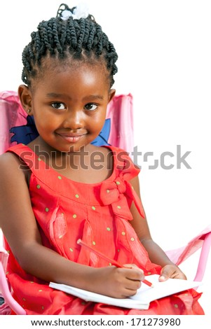 Close up portrait of cute little african girl with note book.Isolated on white background. - stock photo