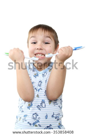 Close up portrait of cute little boy holding toothbrush ready to brush teeth. Morning routine of washing the teeth. Handsome young man is brushing teeth with toothbrush. - stock photo