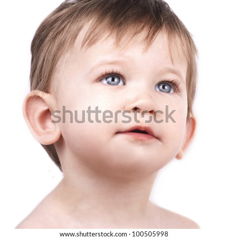 Close up portrait of cute little boy on white background - stock photo