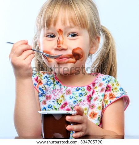 woman playing with yogurt